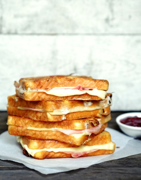 monte cristo sandwich. Grilled ham and cheese, coated in egg and fried in clarified butter.